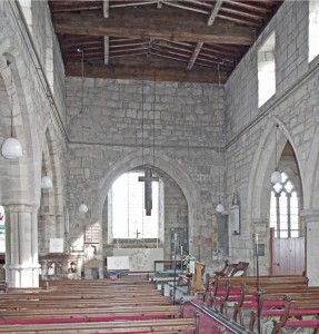 Interior looking east; note earlier roof-line above chancel arch